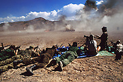 On the desert shooting range during a live fire weapons firing demonstration of Kokalis machine guns at Soldier of Fortune Convention, Las Vegas, Nevada, USA.