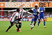 Ipswich midfielder Grant Ward (18) battling for ball with Brentford midfielder Ryan Woods (15)  during the EFL Sky Bet Championship match between Brentford and Ipswich Town at Griffin Park, London, England on 13 August 2016. Photo by Matthew Redman.