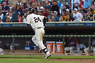 Trevor Plouffe #24 of the Minnesota Twins hits a sacrifice fly against the Detroit Tigers on June 15, 2013 at Target Field in Minneapolis, Minnesota.  The Twins defeated the Tigers 6 to 3.  Photo: Ben Krause