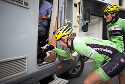 Alison Tetrick (USA) of Cylance Pro Cycling pets the Vos family's cat before the start of the Aviva Women's Tour 2016 - Stage 4. A 119.2 km road race from Nottingham to Stoke-on-Trent, UK on June 18th 2016.