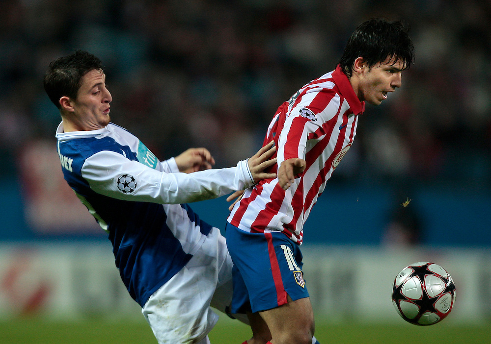 Atletico de Madrid's Sergio 'Kun' Aguero from Argentina, right, vies for the ball with Porto's Cristian Rodriguez from Uruguay, right, during their Group D Champions League soccer match at the Vicente Calderon stadium in Madrid, Tuesday, Dec. 8, 2009.