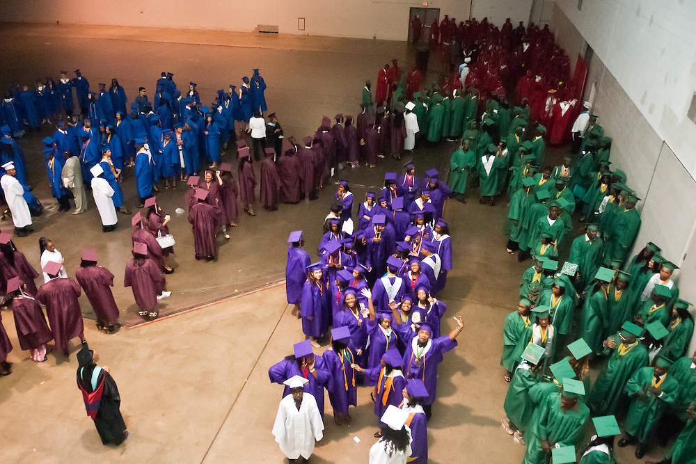 Lathan Goumas | MLive.com..Graduates from Flint schools line up before the 2012 Flint Community Schools commencement ceremony at the Perani Arena in Flint, Mich. on Tuesday June 5, 2012.