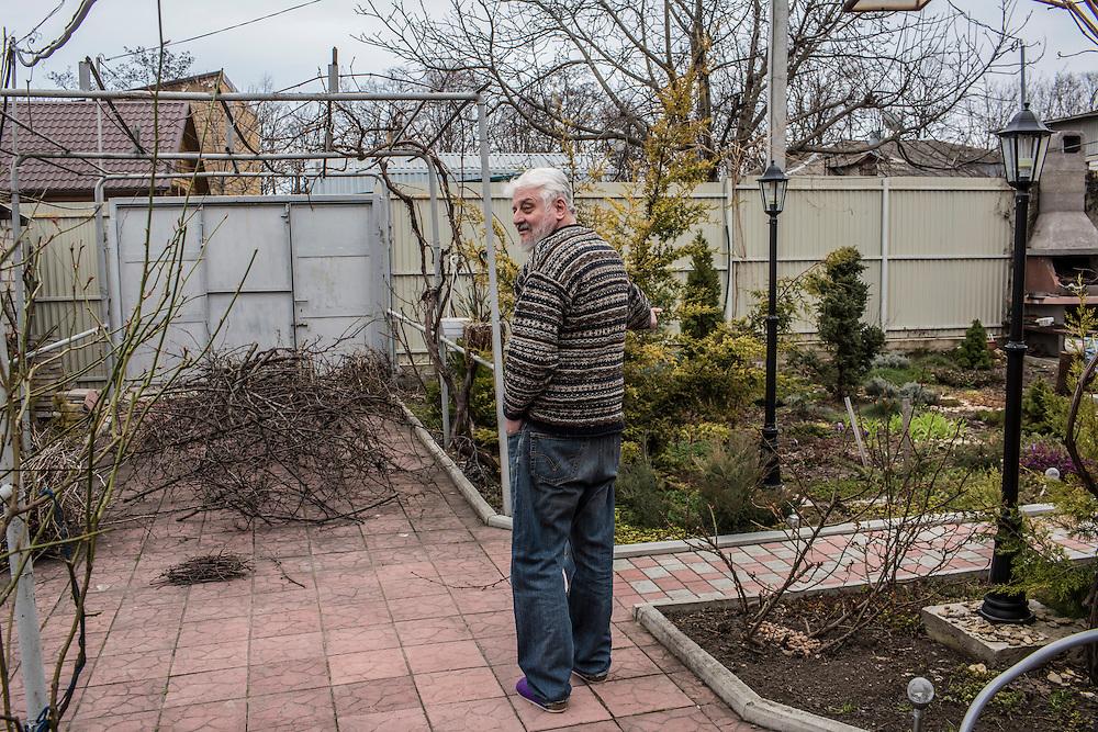 ODESSA, UKRAINE - MARCH 26, 2015: Poet Boris Khersonsky in his garden in Odessa, Ukraine. CREDIT: Brendan Hoffman for The New York Times