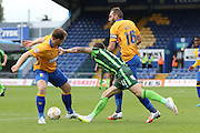 Sean Rigg of AFC Wimbledon is barged by Nicky Hunt the Sky Bet League 2 match between Mansfield Town and AFC Wimbledon at the One Call Stadium, Mansfield, England on 5 September 2015. Photo by Stuart Butcher.