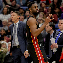 Dec 16, 2018; New Orleans, LA, USA; Miami Heat guard Dwyane Wade (3) reacts after making a three point basket against the New Orleans Pelicans during the second quarter at the Smoothie King Center. Mandatory Credit: Derick E. Hingle-USA TODAY Sports