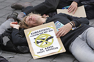 Extinction Rebellion's activists and supporters take part during 'Schiphol Die-In' demonstration at the Schiphol Airport on September 7, 2019 in Amsterdam,Netherlands. Environmental protectors of Extinction Rebellion make a large demonstration at the Schiphol against expansion of aviation and purpose  to draw attention to the views in a positive way, such as limiting the use of fossil fuels and the need to shrink aviation.