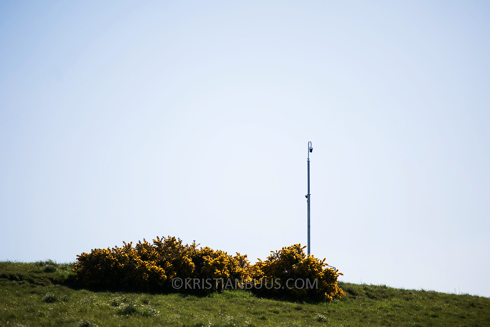 Security CCTV camera in Pont Valley. Day of protest in Pont Valley 5 May 2018 against the extraction of coal by the mining company Banks outside Dipton in Pont Valley, County Durham. Locals have fought the open cast coal mine for thirty years and three times the local council rejected planning permissions but central government has overruled that decision and the company Banks was granted the license and rights to extract coal in early 2018. Locals have teamed up with climate campaigners and together they try to prevent the mining from going ahead. The mining will have huge implications on the local environment and further coal extraction runs agains the Paris climate agreement. A rare species of crested newt live on the land planned for mining and protectors are trying to stop the mine to save the newt.