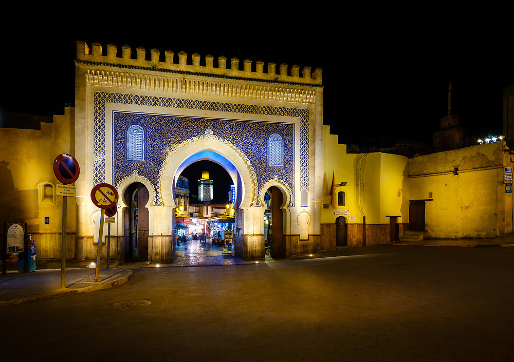 FEZ, MOROCCO - CIRCA MAY 2018:  View of the Bab Bou Jeloud, also known as  The Blue Gate at Night in Fez.