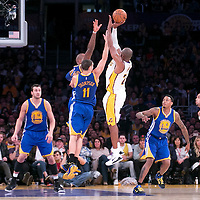 16 November 2014: Los Angeles Lakers guard Kobe Bryant (24) takes a jump shot over Golden State Warriors guard Klay Thompson (11) and Golden State Warriors forward Marreese Speights (5) during the Golden State Warriors 136-115 victory over the Los Angeles Lakers at the Staples Center, Los Angeles, California, USA.