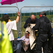 13 local activists locked themselves in specially made arm tubes to block the entrance to Quadrilla's drill site in New Preston Road, July 03 2017, Lancashire, United Kingdom. The 13 activists included 3 councillors; Julie Brickles, Miranda Cox and Gina Dowding and Nick Danby, Martin Porter, Jeanette Porter,  Michelle Martin, Louise Robinson,<br /> Alana McCullough, Nick Sheldrick, Cath Robinson, Barbara Cookson, Dan Huxley-Blyth. The blockade is a repsonse to the emmidiate drilling for shale gas, fracking, by the fracking company Quadrilla. Lancashire voted against permitting fracking but was over ruled by the conservative central Government. All the activists have been active in the struggle against fracking for years but this is their first direct action of peacefull protesting. Fracking is a highly contested way of extracting gas, it is risky to extract and damaging to the environment and is banned in parts of Europe . Lancashire has in the past experienced earth quakes blamed on fracking.