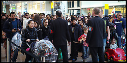 Security Staff hold shoppers back to manage the crowds at the Westfield Shopping Centre in Stratford, East London looking for bargains in the Boxing Day Sales, Monday December 26, 2011. Photo By Andrew Parsons/i-Images