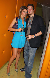 JASPER KAVANAGH and VIOLET VON WESTENHOLTZ at a fashion show by ISSA held at Cocoon, 65 Regent Street, London on 21st September 2005.<br /><br />NON EXCLUSIVE - WORLD RIGHTS