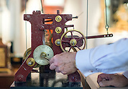 "© Licensed to London News Pictures. 23/10/2014. Guildford, UK. Michael Tooke changes the time mechanism on a turret clock.  clock in the shop. As British Summer Time comes to an end, staff at Horological Workshops start the task of changing the 100's of clocks at their store in Guildford, Surrey, UK. Michael Tooke who has owned the store for over 40 years and worked in the clock business all his life said. ""at this time of year we get a lot of people who bring clocks in for repair after they have changed the time incorrectly by winding back the hands manually"".Clocks change on Sunday morning 26th October. Photo credit : Stephen Simpson/LNP"