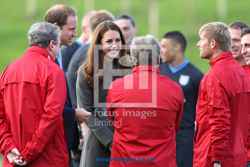 Picture by Paul Terry/Focus Images Ltd +44 7545 642257.09/10/2012.Kate Middleton, the Duchess of Cambridge and Prince William, the Duke of cambridge talk to Roy Hodgson, the England Manager ( L ) and other members of the coaching staff during the Opening of St Georges Park, Burton upon Trent.