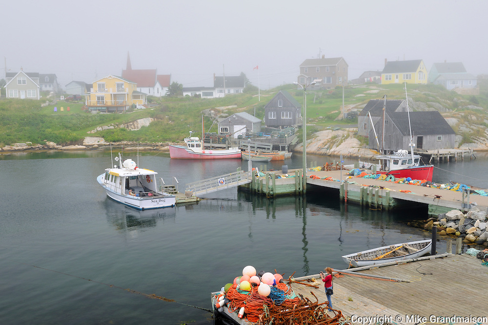 Fishing boats and gear in village<br /> Peggy's Cove <br /> Nova Scotia<br /> Canada