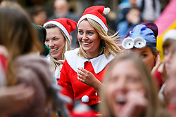 © Licensed to London News Pictures. 05/12/2015. London, UK. Participants taking part at The Great Christmas Pudding Race in Covent Garden, London to support Cancer Research UK on Saturday, 5 December 2015. Photo credit: Tolga Akmen/LNP