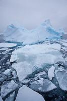 Pack ice and iceberg on sea, Svalbard, Norway.