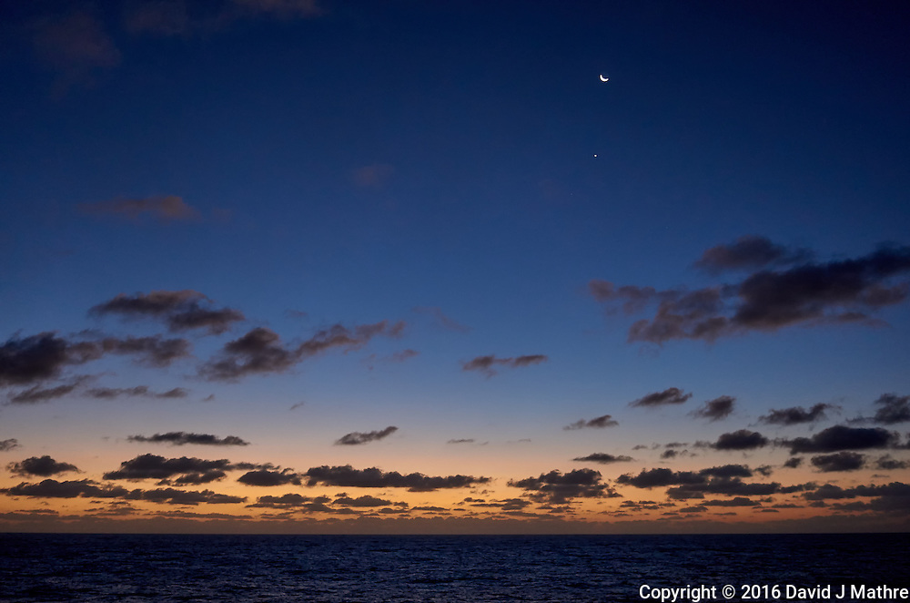 Moon, Venus, and clouds over the Pacific Ocean at dawn from the deck of the MV World Odyssey. Semester at Sea, 2016 Spring Semester Voyage. Day 2 of 102. Image taken with a Leica T camera and 23 mm f/2 lens (ISO 1250, 23 mm, f/2, 1/80 sec).