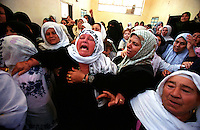 Woman cry at the wake of a victim of an Israeli incursion into Gaza City. Israeli forces enter Gaza on almost a daily basis trying to locate militant groups, destroy buildings that they believe are used to manufacture weapons and destroy homes of the families of Martyrs. (Photo/Scott Dalton)