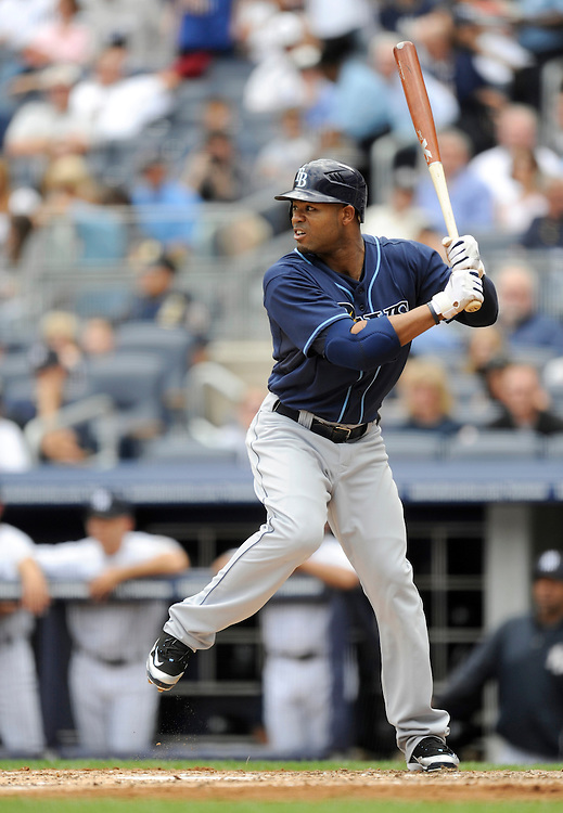 NEW YORK - JUNE 06: Carl Crawford #13 of the Tampa Bay Rays bats  against the New York Yankees on June 6, 2009 at Yankee Stadium in the Bronx borough of New York City. The Rays defeated the Yankees 9 to 7. (Photo by Rob Tringali) *** Local Caption *** Carl Crawford