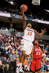 Virginia guard Monica Wright (22) shoots against NC State.  The Virginia Cavaliers defeated the NC State Wolfpack women's basketball team 74-49 at the John Paul Jones Arena in Charlottesville, VA on February 1, 2008.