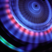Looking down at a centrifuge testing the samples  at a very high speed using a blue light to show the separation. <br />