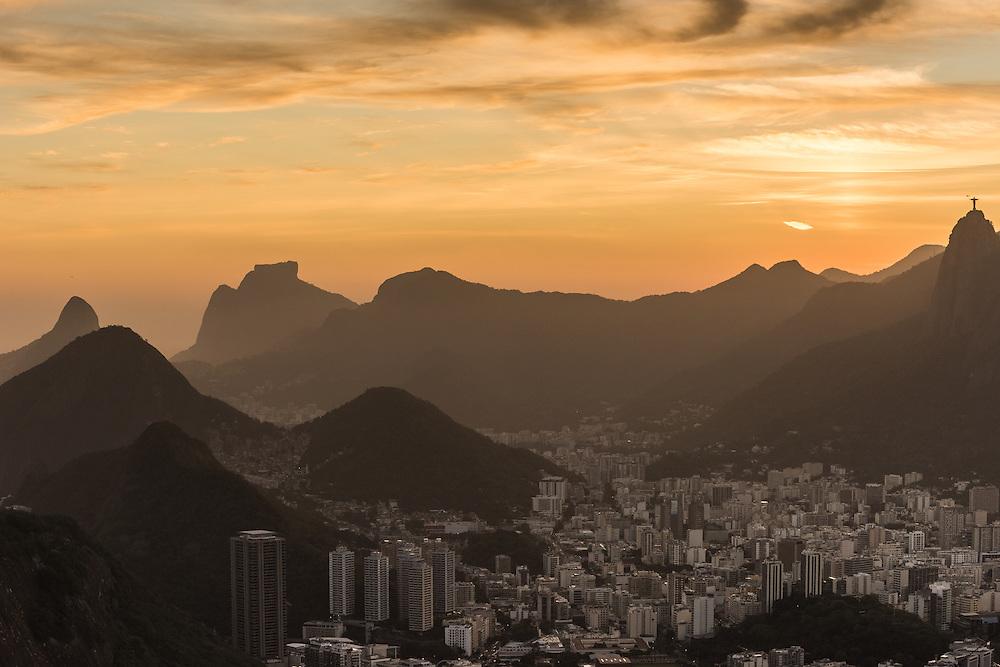 The city of Rio de Janeiro at sunset with on the background the status of Christo redentor, Rio de Janeiro, Brazil.