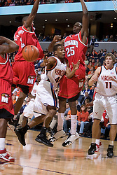 Virginia's Sean Singletary (44) passes around Maryland defenders Ekene Ibekwe (25) and D.J. Strawberry (2).  The Cavaliers defeated the #22 ranked Terrapins 103-91 at the John Paul Jones Arena in Charlottesville, VA on January 16, 2007.