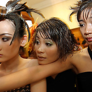 Models backstage check out their order-of-appearance before hitting the catwalk at a fashion show in Hanoi, Vietnam. With government-instituted market reforms and a rapidly growing economy, young urban Vietnamese now have more disposable income to spend on mobile phones, slick motorbikes and up-to-date fashions.