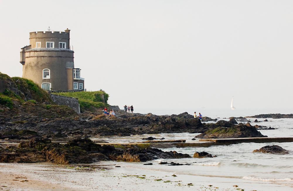 The Napoleonic wars martello tower coastal defence above the beach at Portmarnock near Malahide, County Dublin, Ireland.