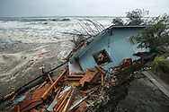 (Gabe Green   The Daily World)<br /> <br /> Waves crash against a North Cove home which fell into the ocean along Washday beach early Wednesday morning after strong surf caused by severe wind eroded it's foundation.
