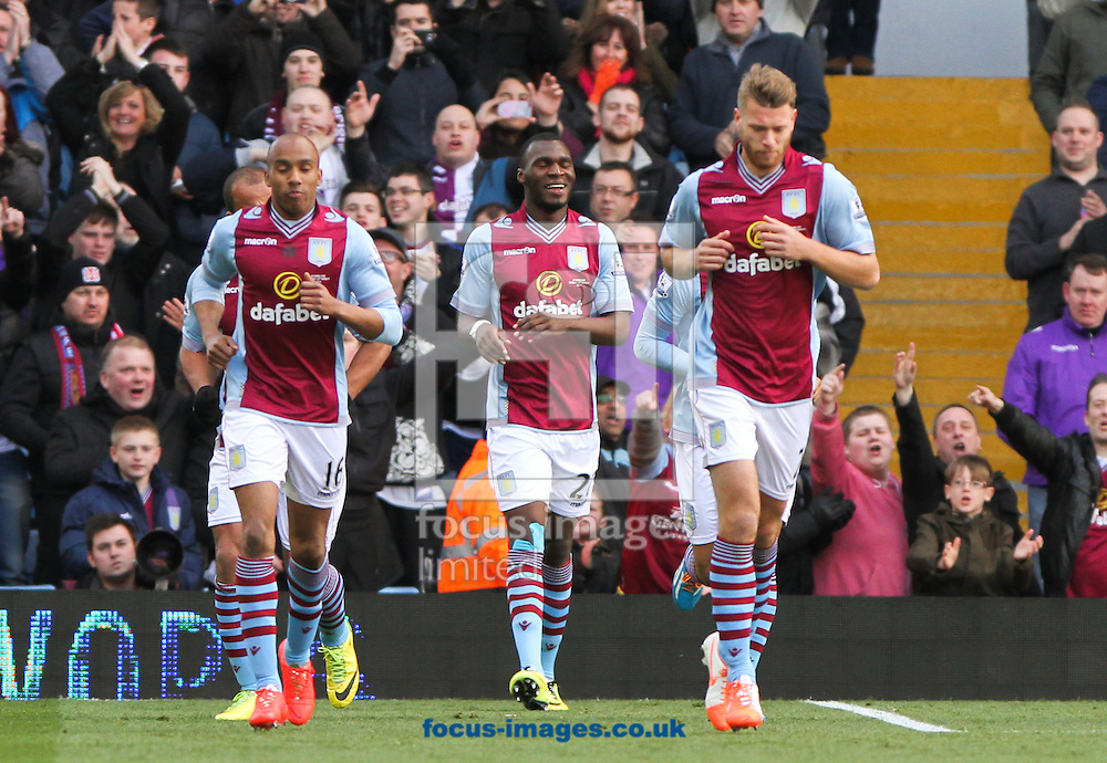 Christian Benteke (centre) of Aston Villa celebrates scoring his sides first goal with his team mates during the Barclays Premier League match at Villa Park, Birmingham<br /> Picture by Tom Smith/Focus Images Ltd 07545141164<br /> 23/03/2014
