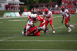 19 September 2009: Doni Phelps puts the stop on Ryan White with assists from Kelvyn Hemphill and Chris Garrett in a game which the Austin Peay Governors were defeated 38-7 by the Illinois State Redbirds at Hancock Stadium on campus of Illinois State University in Normal Illinois