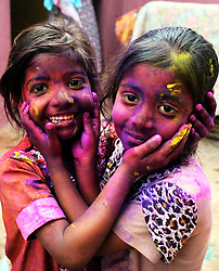 61234115<br /> Pakistani Hindu children pose with coloured powder on their faces as they celebrate Holi festival in southern Pakistani port city of Karachi on March 16, 2014. Holi, the popular Hindu spring festival of colours, is observed in Pakistan at the end of the winter season on the last full moon day of the lunar month. Sunday, 16th March 2014. Picture by  imago / i-Images<br /> UK ONLY
