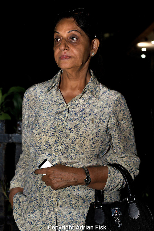 58 yr old Madhu Kapur looks towards the Oberoi hotel where her husband is being held by unknown gunmen. She along with others managed to get out but her husband was unable to get away. Whilst walking down steps inside the hotel the gunman just behind her shot dead a man also walking just behind her. The fate of her husband is unknown at this point.