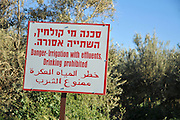 "A warning sign in Hebrew, Arabic and English: ""Danger irrigation with effluent, drinking prohibited"" Due to a shortage of water, Israel is trying to find ways of conserving potable water"