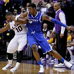 January 28, 2012; Baton Rouge, LA; LSU Tigers guard Andre Stringer (10) and Kentucky Wildcats forward Terrence Jones (3) get tied up together during the second half of a game at the Pete Maravich Assembly Center. Kentucky defeated LSU 74-50.  Mandatory Credit: Derick E. Hingle-US PRESSWIRE
