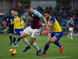 James Tarkowski of Burnley (L) and Shane Long of Southampton in action - Mandatory by-line: Jack Phillips/JMP - 02/02/2019 - FOOTBALL - Turf Moor - Burnley, England - Burnley v Southampton - English Premier League