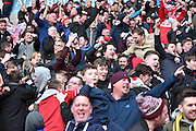 The Middlesbrough fans celebrate during the Sky Bet Championship match between Bolton Wanderers and Middlesbrough at the Macron Stadium, Bolton, England on 16 April 2016. Photo by Mark Pollitt.