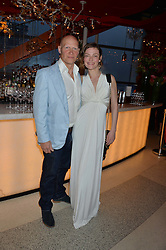 CAMILLA RUTHERFORD and DOMINIC BURNS at the OMEGA 100 days to Rio Olympics VIP Dinner at Sushi Samba, Heron Tower, 110 Bishopsgate, City of London on 27th April 2016.
