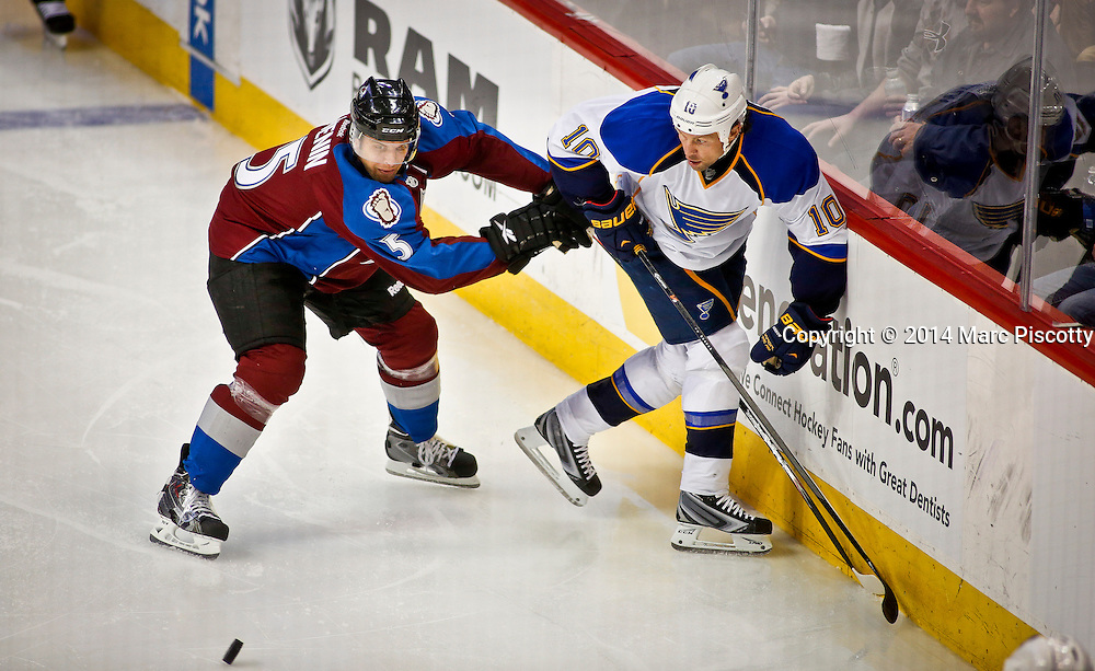 SHOT 3/8/14 2:57:50 PM - The Colorado Avalanche's Nate Guenin #5 battles the St. Louis Blues' Brenden Morrow #10 along the boards during their regular season Western Conference game at the Pepsi Center in Denver, Co. The Blues won the game 2-1.<br /> (Photo by Marc Piscotty / &copy; 2014)