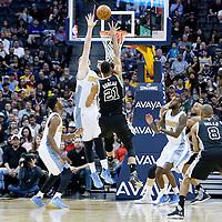 08 April 2016: San Antonio Spurs center Tim Duncan (21) goes for the hook shot over Denver Nuggets center Jusuf Nurkic (23) during the Denver Nuggets 102-98 victory over the San Antonio Spurs, at the Pepsi Center, Denver, Colorado, USA.