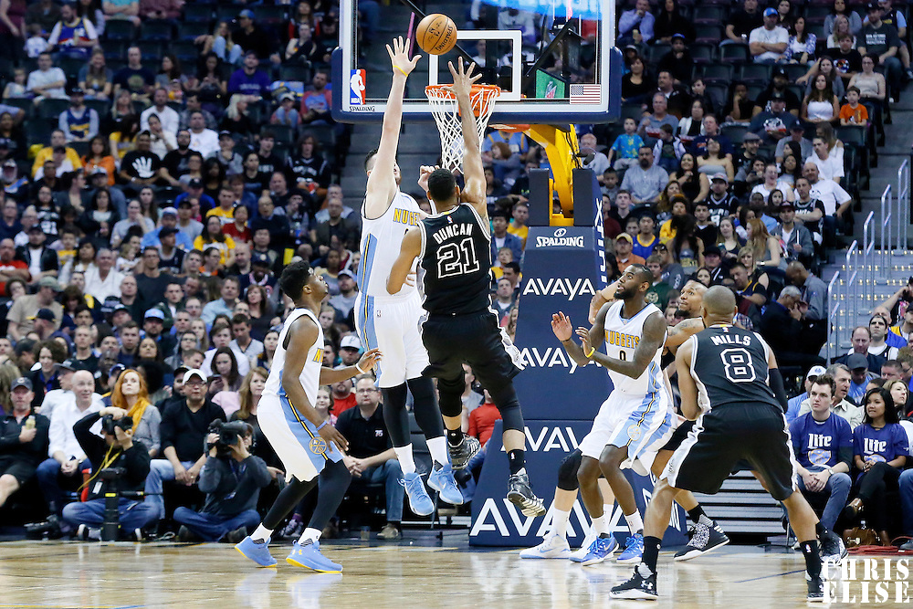08 April 2016: San Antonio Spurs center Tim Duncan (21) goes for the hook shot over Denver Nuggets center Jusuf Nurkic (23) during the Denver Nuggets 102-98 victory over the San Antonio Spurs, at the Pepsi Center, Denver, Colorado, USA.