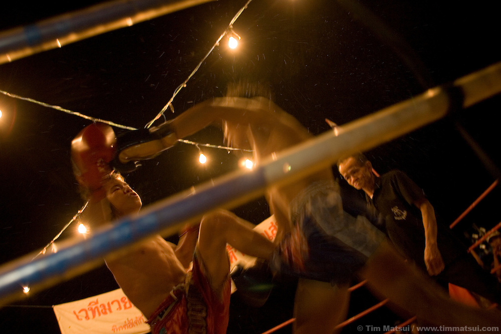 Young Mui Thai kick boxers compete at a small fair near Chiang Mai, Thailand.