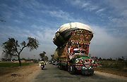 A truck carries harvested rice to a mill in Larkana, Pakistan, on Tuesday, Jan. 22, 2008. Rising cereal prices worldwide may put 300 million rural poor at risk of starvation in South Asian countries such as India, Pakistan and Bangladesh, the Asian Development Bank said.