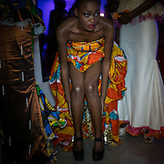 A model wearing her shoses before Marcia creation show during the Kinshasa Fashion week. CAPTA/FEDERICO SCOPPA