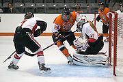 RIT Senior Captain Celeste Brown fights for a puck in the crease during an exhibition game at RIT's Gene Polisseni Center on Monday, September 29, 2014.