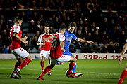 Peterborough United midfielder Alex Woodyard (4) gets tackled bt Fleetwood Town defender Craig Morgan (20) during the EFL Sky Bet League 1 match between Peterborough United and Accrington Stanley at London Road, Peterborough, England on 20 October 2018.