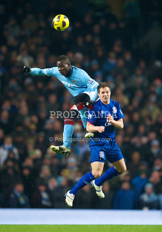 MANCHESTER, ENGLAND - Monday, December 20, 2010: Everton's Phil Jagielka and Manchester City's Mario Balotelli during the Premiership match at the City of Manchester Stadium. (Pic by: David Rawcliffe/Propaganda)