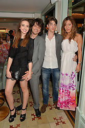 Left to right, SARAH STANBURY, FENTON BAILEY, SASCHA BAILEY and his fiance MIMI NISHIKAWA at the 50th anniversary party for Daphne's restaurant, 112 Draycott Avenue, London held on 24th June 2014.